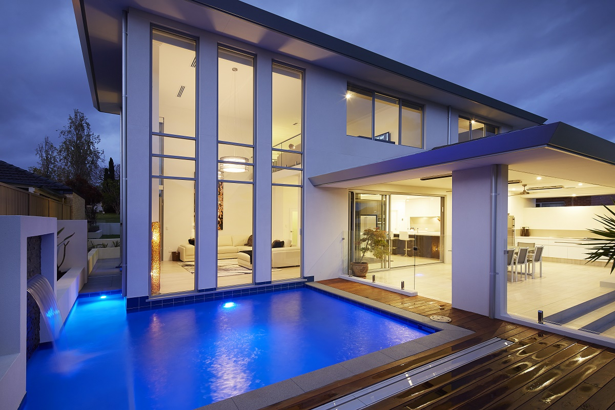Wrap around pools pools that wrap house for Pool design companies