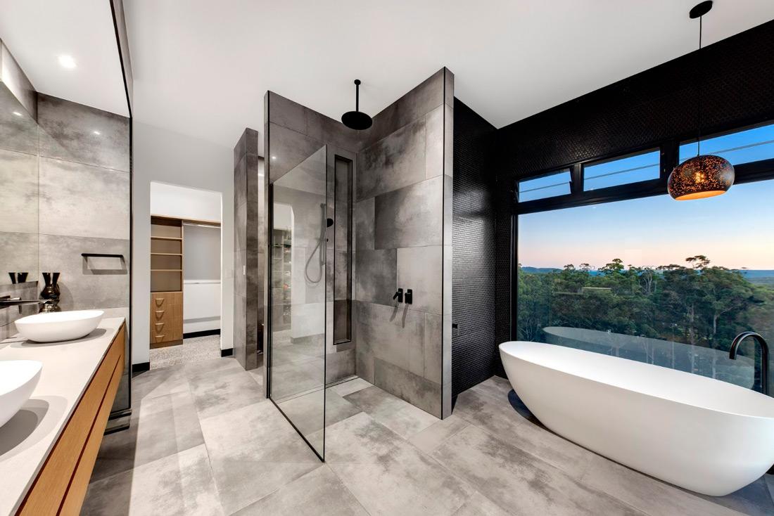 Bathroom with bathtub next to a large window