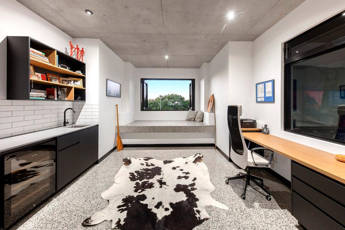 room with desktop, window and animal print rug