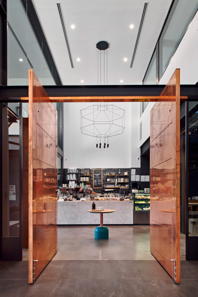 Open doors to kitchen in showroom