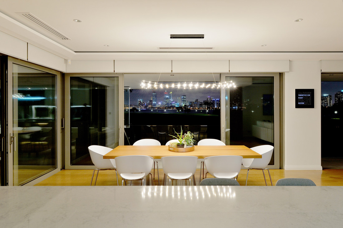 South Perth Custom Homes dinning room at night