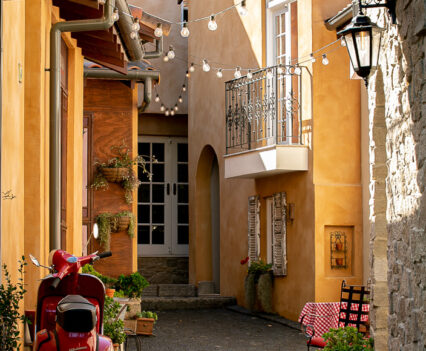 Tuscan Style Homes street with red pasola