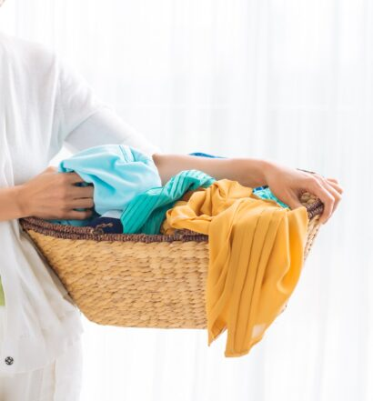 Powered laundry chute